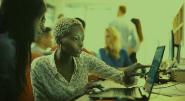 modernize your data warehouse woman at computer