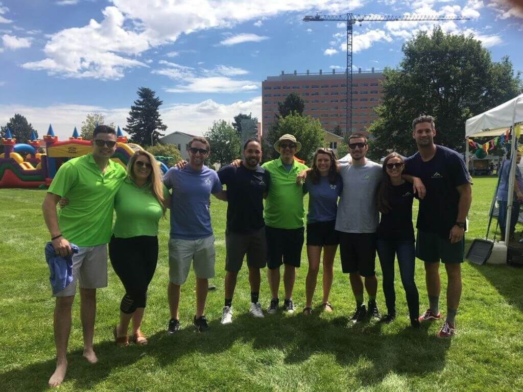 A group of Matillion employees on a lawn volunteering for Brent's Place and living Matillion values